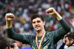 Real Madrid's Belgian goalkeeper Thibaut <HIT>Courtois</HIT> celebrates after winning the Spanish Super Cup final between Real Madrid and Atletico Madrid on January 12, 2020, at the King Abdullah Sports City in the Saudi Arabian port city of Jeddah. (Photo by Giuseppe CACACE / AFP)
