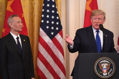 US President Donald <HIT>Trump</HIT> and China's Vice Premier Liu He, the country's top trade negotiator, hold a press conference before they sign a trade agreement between the US and China during a ceremony in the East Room of the White House in Washington, DC on January 15, 2020. (Photo by SAUL LOEB / AFP)