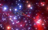Recreación de las órbitas de objetos G en el centro de la Vía Láctea. El agujero negro está indicado con una cruz blanca.