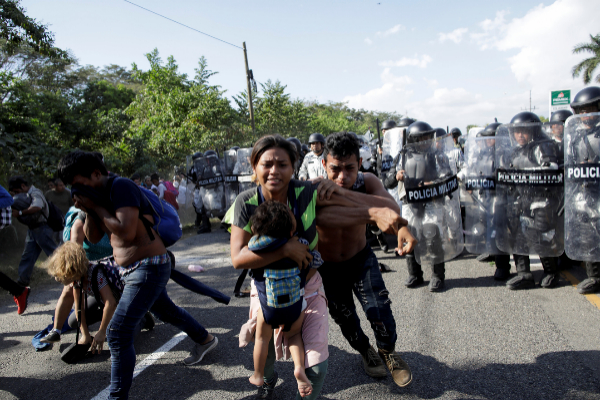 Migrants, mainly from Central America and marching in a caravan,...