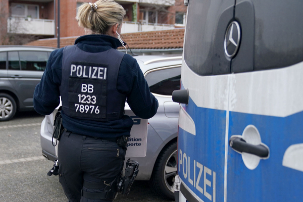 Wildau (<HIT>Germany</HIT>).- A <HIT>police</HIT> officer carries...