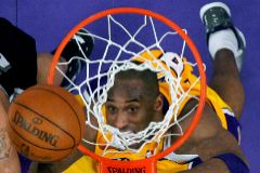 FILE PHOTO: Los Angeles Lakers <HIT>Kobe</HIT> Bryant eyes a rebound against the San Antonio Spurs during their NBA basketball game in Los Angeles