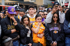 Mourners gather in Microsoft Square near the Staples Center to pay respects to <HIT>Kobe</HIT> Bryant after a helicopter crash killed the retired basketball star, in Los Angeles