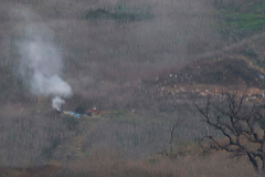 Smoke rises from the site of a helicopter crash in Calabasas on Sunday, January 26, 2020 that killed 5 people included former Los Angeles Laker star <HIT>Kobe</HIT> Bryant and his daughter Gianna Maria. - NBA legend <HIT>Kobe</HIT> Bryant died Sunday in a helicopter crash in suburban Los Angeles, celebrity website TMZ reported, saying five people are confirmed dead in the incident. (Photo by Mark RALSTON / AFP)