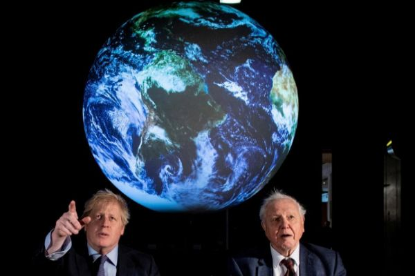British Prime Minister Boris Johnson and David Attenborough attend a...