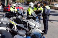 Cuatro agentes de la Policía Local de Málaga.