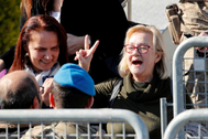 Mucella Yapici, who is one of the 16 defendants acquitted over their alleged role in Turkey's Gezi Park protests case, gestures after leaving a courtroom at the Silivri Prison and Courthouse complex