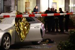 A body is seen near a damaged car after a shooting in lt;HIT gt;Hanau lt;/HIT gt; near Frankfurt