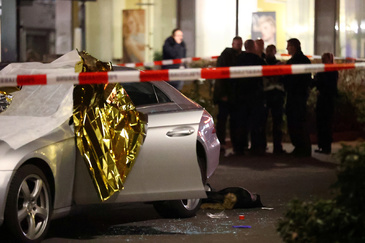 A body is seen near a damaged car after a shooting in lt;HIT gt;Hanau lt;/HIT gt; near Frankfurt