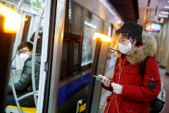 People wear face masks on the metro in Beijing as the country is hit by an outbreak of the novel coronavirus