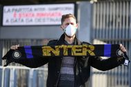 A man wearing a face mask stands outside the lt;HIT gt;San lt;/HIT gt; lt;HIT gt;Siro lt;/HIT gt; stadium after the Inter Milan v Sampdoria Serie A match was cancelled due to an outbreak of the coronavirus in Lombardy and Veneto, in Milan