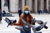 lt;HIT gt;Milan lt;/HIT gt; (Italy).- Pigeons circle around a tourist wearing a protective face mask in Duomo square in lt;HIT gt;Milan lt;/HIT gt;, Italy, 05 March 2020. All schools and learning institutions across Italy have been shut down until 15 March 2020 in a bid to stem the spread of the SARS-CoV-2 lt;HIT gt;coronavirus lt;/HIT gt; that causes the COVID-19 disease. So far, there have been at least 2,700 confirmed cases and 107 deaths from the disease in the Mediterranean country. Ansa/ (Italia) EPA/