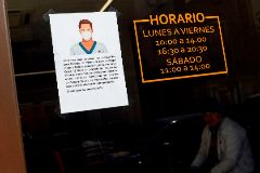 A sign written in Spanish and Chinese offers an apology to costumers for the use of protective masks in light of the novel lt;HIT gt;coronavirus lt;/HIT gt; outbreak, inside a store in the Usera neighbourhood in lt;HIT gt;Madrid lt;/HIT gt;, on March 10, 2020. - Spain has seen a spike in the novel lt;HIT gt;coronavirus lt;/HIT gt; cases in the last 24 hours, with 1,622 infections and 35 deaths. (Photo by OSCAR DEL POZO / AFP)