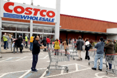 Customers queue to enter a Costco Wholesalers in lt;HIT gt;Chingford lt;/HIT gt;, Britain