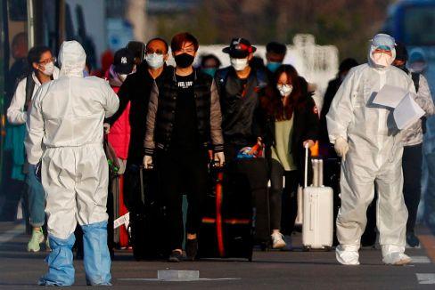 Los chinos que 'huyen' de sus tiendas en Madrid y dan positivo en Pekín