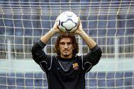 FILE PHOTO: FC Barcelona's Turkish goalkeeper lt;HIT gt;Rustu lt;/HIT gt; Recber blocks the ball during his presentation at the Nou Camp stadium in Barcelona