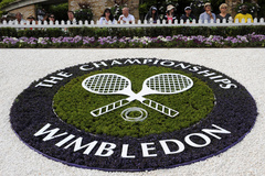 FILE PHOTO: A lt;HIT gt;Wimbledon lt;/HIT gt; logo is seen inside the grounds at the lt;HIT gt;Wimbledon lt;/HIT gt; tennis championships in London