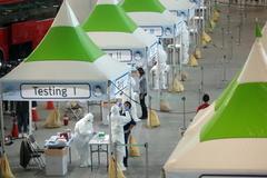 Control sanitario de pasajeros en el aeropuerto internacional de Seúl