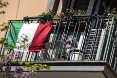 Rome (Italy).- A man sits next to an Italian flag on his balcony on Easter Sunday during the emergency blockade in Rome, Italy, 12 April 2020. Countries around the world are taking measures to contain the widespread of the SARS-CoV-2 coronavirus which causes the Covid-19 disease. ( lt;HIT gt;Italia lt;/HIT gt;, Roma) EPA/