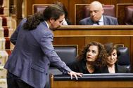 El vicepresidente del Gobierno, Pablo Iglesias, y la ministra María Jesús Montero, en febrero, en el Congreso.