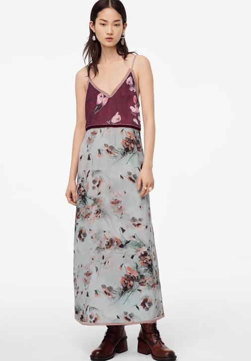 Vestido combinado de Zara con detalles de terciopelo y pasamanería.