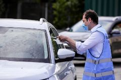 Berlin (Germany).- A member of the Neukoelln district Pandemic Staff hands over a smear-test to a motorist at a drive-in COVID-19 test station at Neukoelln district in Berlin, Germany, 24 April 2020. The station is opererted by the health department of Neukoelln district and offers pre set appointments for both drive-through and walk through lt;HIT gt;tests lt;/HIT gt;. The German government and local authorities are beginning to consider to gradually ease restrictions made to cope with the spread of the lt;HIT gt;coronavirus lt;/HIT gt; SARS-CoV-2 which causes the COVID-19 disease. (Alemania) EPA/