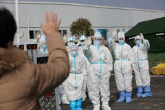 FILE PHOTO: Medical personnel in protective suits wave hands to a patient who is discharged from the Leishenshan Hospital after recovering from the novel coronavirus, in lt;HIT gt;Wuhan lt;/HIT gt;