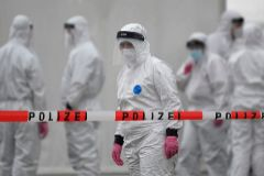 """TOPSHOT - Members of a coronavirus testing station stand on the factory premises of the Westfleisch meat processing company in lt;HIT gt;Hamm lt;/HIT gt;, western Germany, on May 10, 2020, as all workers of the company have to be tested on the novel coronavirus after a spike in cases at their slaughterhouse. - Local authorities in the western federal state of North Rhine-Westphalia announced on May 8, 2020 that reopening plans were postponed and an """"emergency mechanism"""" would come into effect due to high infection rates in the region. Many of the Westfleisch company's workers, partially originating from Eastern Europe and housed in shared accomodation, were tested positive on the novel coronavirus that can cause the COVID-19 disease. (Photo by Ina FASSBENDER / AFP)"""