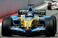 FILE PHOTO: Renault's Formula One world champion lt;HIT gt;Fernando lt;/HIT gt; lt;HIT gt;Alonso lt;/HIT gt; waves to supporters after winning the Spanish Grand Prix at the Circuit de Catalunya in Montmelo, near Barcelona