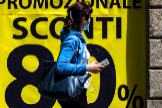 Rome (Italy).- A person wearing a face mask walks past a shop window of a clothing store displaying a promotional sale banner during the Phase 2 of the coronavirus Covid-19 pandemic emergency in Rome, Italy, 19 May 2020. Several countries around the globe have started to ease COVID-19 lockdown restrictions in an effort to restart their economies and help people in their daily routines after the outbreak of COVID-19. ( lt;HIT gt;Italia lt;/HIT gt;, Roma) EPA/