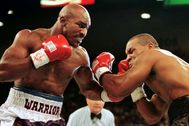 FILE PHOTO: WBA Heavyweight Champion Evander Holyfield (R) connects to the jaw of challenger Mike lt;HIT gt;Tyson lt;/HIT gt; in the f