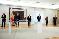 Antonio Garamendi y el presidente del Gobierno, en la firma del acuerdo para prorrogar los ERTE en Moncloa.