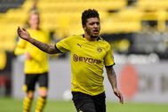 lt;HIT gt;Dortmund lt;/HIT gt;'s English midfielder Jadon Sancho vies for the ball during the German first division Bundesliga football match BVB Borussia lt;HIT gt;Dortmund lt;/HIT gt; v Schalke 04 on May 16, 2020 in lt;HIT gt;Dortmund lt;/HIT gt;, western Germany as the season resumed following a two-month absence due to the novel coronavirus COVID-19 pandemic. (Photo by Martin Meissner / POOL / AFP) / DFL REGULATIONS PROHIBIT ANY USE OF PHOTOGRAPHS AS IMAGE SEQUENCES AND/OR QUASI-VIDEO