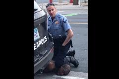 Miles de personas protestan por la muerte de un afroamericano a manos de policías