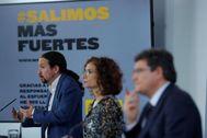 Pablo Iglesias, María Jesús Montero y José Luis Escrivá, en rueda de prensa tras el Consejo de Ministros.