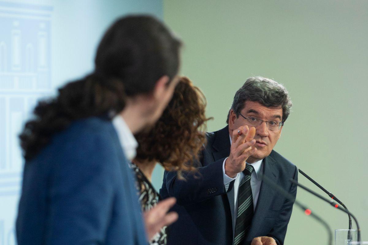 Pablo Iglesias, María Jesús Montero y Jose Luis Escrivá, en la rueda de prensa posterior al Consejo de Ministros.
