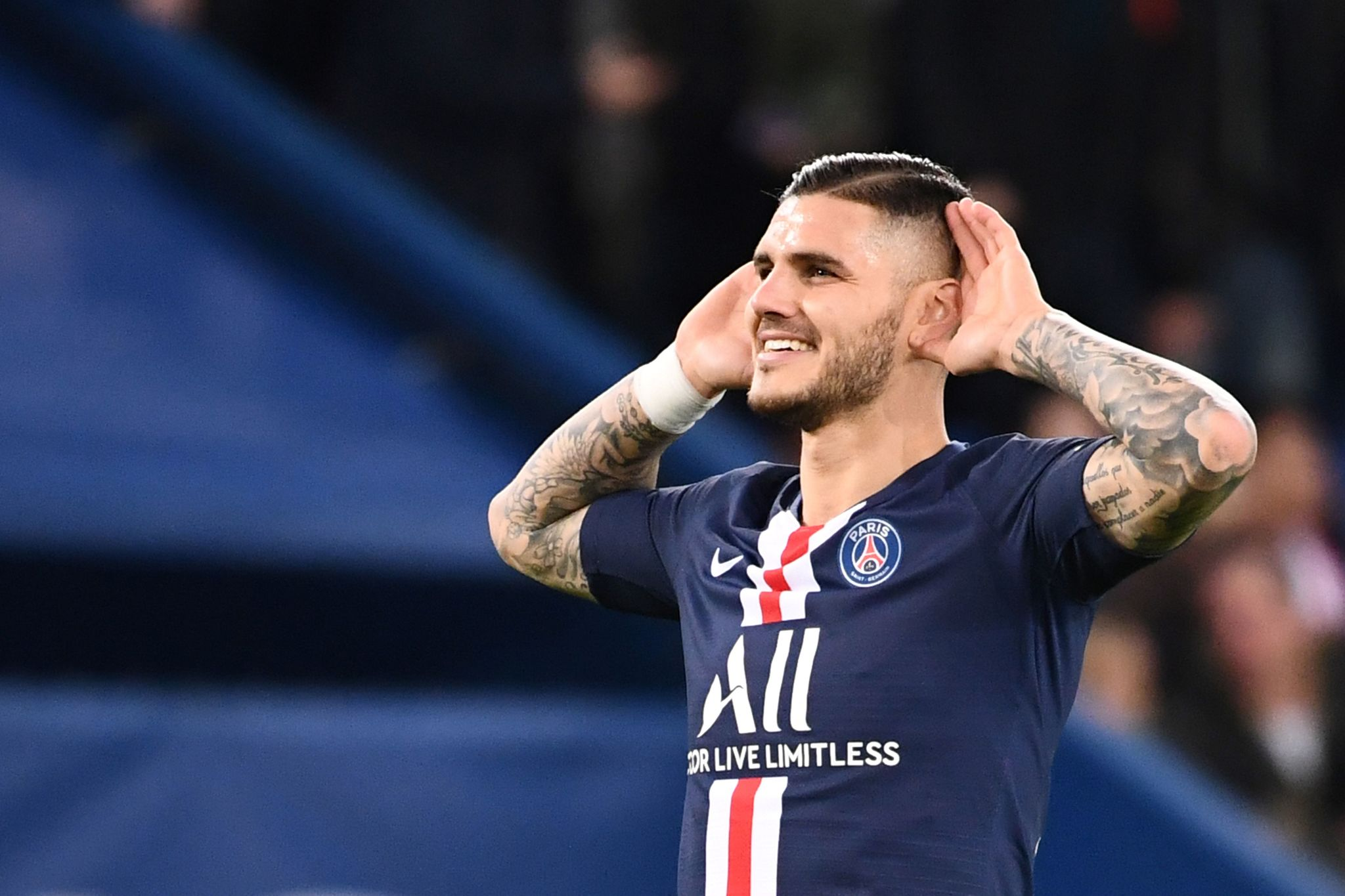 (FILES) In this file photo taken on November 22, 2019 Paris Saint-Germain's Argentine forward Mauro lt;HIT gt;Icardi lt;/HIT gt; celebrates after scoring a goal during the French L1 football match between Paris Saint-Germain (PSG) and Lille (LOSC) at the Parc des Princes in Paris. - Mauro lt;HIT gt;Icardi lt;/HIT gt; remains in Paris. The Argentine striker, on loan since the start of the 2019-20 season from Inter Milan, has signed a 4-year contract until 2024 with the Parisian club, Paris Saint-Germain announced on May 31, 2020. (Photo by FRANCK FIFE / AFP)
