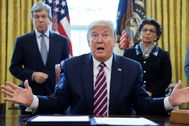 FILE PHOTO: U.S. President lt;HIT gt;Trump lt;/HIT gt; participates in coronavirus relief bill signing ceremony at the White House in Washington
