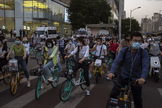 lt;HIT gt;Beijing lt;/HIT gt; (China).- People wearing protective face masks ride bicycles and scooters on a street amid the ongoing coronavirus COVID-19 pandemic in lt;HIT gt;Beijing lt;/HIT gt;, China, 02 June 2020. Several countries around the world have started to ease COVID-19 lockdown restrictions in an effort to restart their economies and help people in their daily routines. EPA/