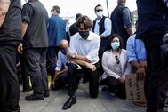 Canada's Prime Minister lt;HIT gt;Justin lt;/HIT gt; lt;HIT gt;Trudeau lt;/HIT gt; wears a mask as he takes a knee during a rally against the death in Minneapolis police custody of George Floyd, on Parliament Hill, in Ottawa