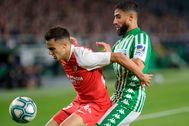 (FILES) In this file photo taken on November 10, 2019 Real lt;HIT gt;Betis lt;/HIT gt;' French midfielder Nabil Fekir (R) vies with Sevilla's Spanish defender Sergio Reguilon during the Spanish league football match Real lt;HIT gt;Betis lt;/HIT gt; against Sevilla FC at the Benito Villamarin stadium in Seville on November 10, on 2019. - The derby between Sevilla and Real lt;HIT gt;Betis lt;/HIT gt; will end a 93-day hiatus and launch a five-week sprint to the finish on June 11, 2020. (Photo by CRISTINA QUICLER / AFP)