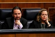 Los vicepresidentes Pablo Iglesias y Nadia Calviño en el Congreso de los Diputados.