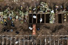 TOPSHOT - Aerial view showing a burial of a victim of COVID-19 at the General Cemetery in Santiago June 15, 2020 amid the novel coronavirus pandemic