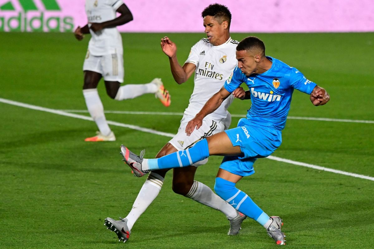Real Madrid's French defender Raphael Varane (L) vies with Valencia's Spanish forward lt;HIT gt;Rodrigo lt;/HIT gt; lt;HIT gt;Moreno lt;/HIT gt; during the Spanish league football match between Real Madrid CF and Valencia CF at the Alfredo di Stefano stadium in Valdebebas, on the outskirts of Madrid, on June 18, 2020. (Photo by JAVIER SORIANO / AFP)