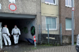 Police officers wearing protective suits are seen at a block of flats that has been quarantined after dozens of residents tested positive for the coronavirus disease (COVID-19), in lt;HIT gt;Goettingen lt;/HIT gt; near Hannover June 18, 2020. REUTERS/Annkathrin Weis