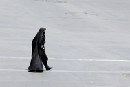 Tehran (Iran (islamic Republic Of)).- An Iranian woman wearing a face mask walks at a street, in Tehran, Iran, 30 June 2020. According to figures released by the Iranian Health Ministry on 29 June 2020, the country recorded its highest number of deaths from the coronavirus disease (COVID-19), 162 deaths and more than 2,000 new cases diagnosed within a 24-hour period. ( lt;HIT gt;Teherán lt;/HIT gt;) EPA/