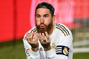 Real Madrid's Spanish defender Sergio lt;HIT gt;Ramos lt;/HIT gt; celebrates after scoring during the Spanish league football match Real Madrid CF againsrt Getafe CF at the Alfredo di Stefano stadium in Valdebebas, on the outskirts of Madrid, on July 2, 2020. (Photo by GABRIEL BOUYS / AFP)