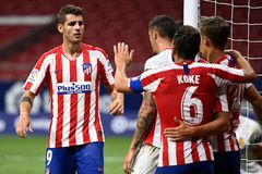 Atletico Madrid's Spanish forward Alvaro Morata (L) celebrates with teammates after scoring a second goal during the Spanish League football match between Atletico Madrid and Mallorca at the lt;HIT gt;Wanda lt;/HIT gt; Metropolitan stadium in Madrid on July 3, 2020. (Photo by PIERRE-PHILIPPE MARCOU / AFP)