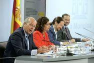Juan Carlos Campo, María Jesús Montero, Pablo Iglesias y José Luis Ábalos en la rueda de prensa de este martes.