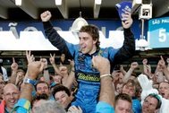lt;HIT gt;Renault lt;/HIT gt;'s Formula One driver Fernando lt;HIT gt;Alonso lt;/HIT gt; of Spain celebrates with the lt;HIT gt;Renault lt;/HIT gt; team after finishing second in the Brazilian Grand Prix, the last F1 race of the season, at the Interlagos track in Sao Paulo, October 22, 2006. lt;HIT gt;Alonso lt;/HIT gt; won his second successive Formula One world championship at the Brazilian Grand Prix on Sunday. The 25-year-old Spaniard, needing only one point to secure the title, finished second in the season-ending race at Interlagos. Ferrari's Michael Schumacher, who had to win to have any hope of a record eighth title in his last race before retirement, was fourth. REUTERS/Paulo Whitaker (BRAZIL) - GM1DTTVHHUAA